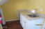 9068 NW Grouse Ct, Seal Rock, OR 97376 - kitchen area lower level
