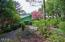 7234 SW Surfland St.,, South Beach, OR 97366 - Lush Landscaping