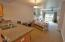 475 SE 35th St St, E-25, South Beach, OR 97366 - Kitchen to Living