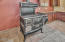 4358 NE East Devils Lake Rd, Otis, OR 97368 - Kitchen with Woodburning stove