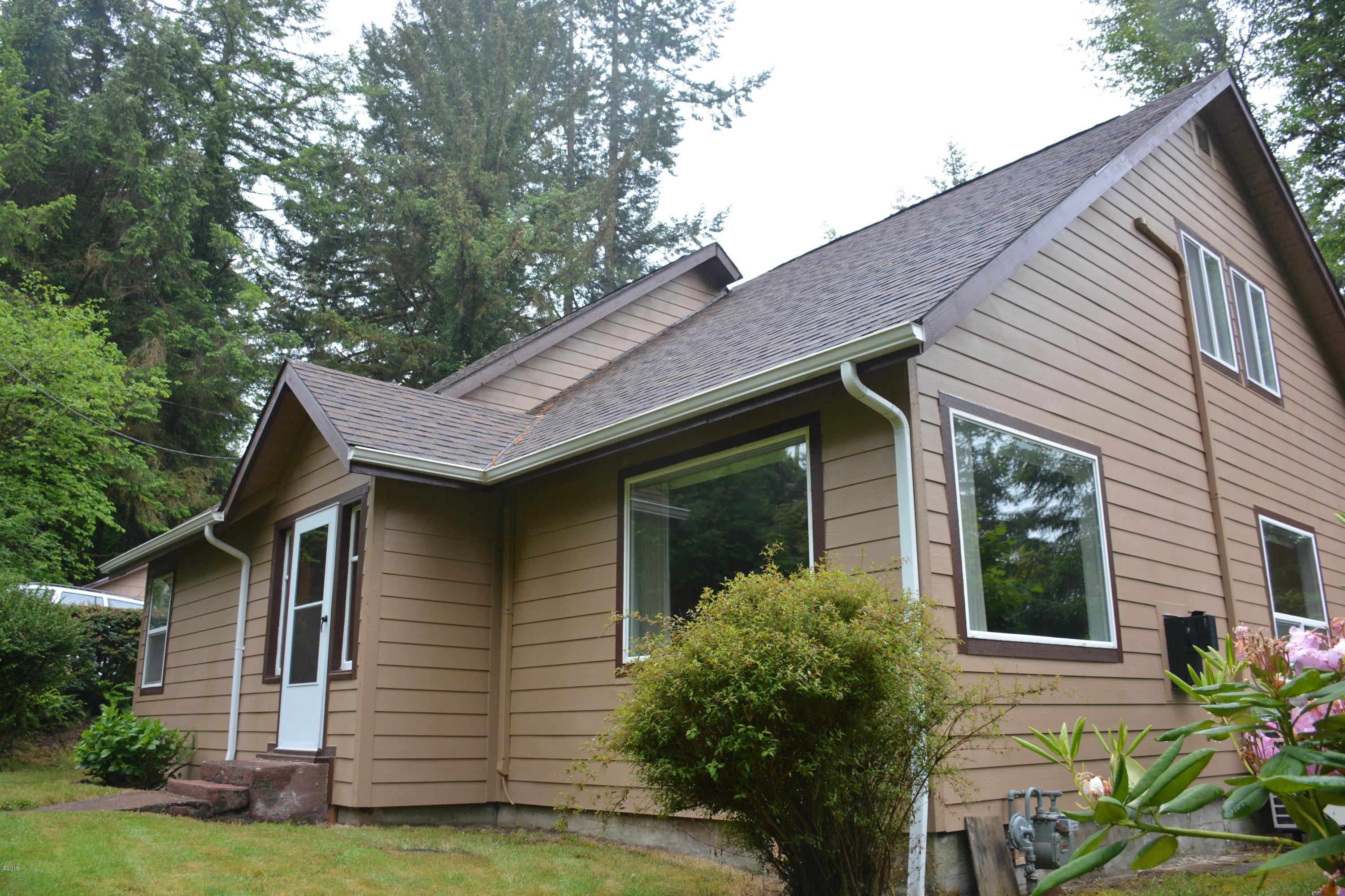 1175 NW Dundon Rd, Toledo, OR 97391 - Front and north side of home