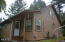 1175 NW Dundon Rd, Toledo, OR 97391 - Back entry and south side of home