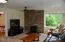 1175 NW Dundon Rd, Toledo, OR 97391 - Living room with gas fireplace