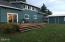 4974 NE 49th St, Neotsu, OR 97364 - Back deck with a lake view