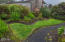 65 SW 100th Ct, South Beach, OR 97366 - Perfectly landscaped