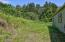 974 NW Wild Rose Ln, Seal Rock, OR 97376 - Back of Houe