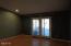 5340 La Fiesta Way, Lincoln City, OR 97367 - Master bedroom w/doors to rear yard