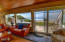 65 SW 100th Ct, South Beach, OR 97366 - living room and deck