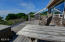 65 SW 100th Ct, South Beach, OR 97366 - deck with hot tub