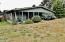 286 NE Evergreen Ln, Yachats, OR 97498 - Covered Porch from yard