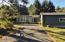 286 NE Evergreen Ln, Yachats, OR 97498 - House in A.M. Sun from driveway