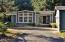 286 NE Evergreen Ln, Yachats, OR 97498 - A.M. Sun on House & Drive