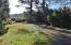 286 NE Evergreen Ln, Yachats, OR 97498 - Yard in Sun