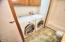 590 SW Range Dr, Waldport, OR 97394 - Laundry in Guest Bath