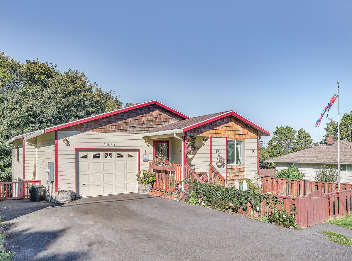 2031 NE Oar Ave, Lincoln City, OR 97367 - Front including Diveway