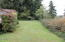 2294 SE Merten Dr, Waldport, OR 97394 - back yard facing w.