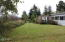 2294 SE Merten Dr, Waldport, OR 97394 - back yard facing E.