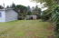 2294 SE Merten Dr, Waldport, OR 97394 - back yard to driveway