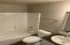 835 NW Bernard St, Seal Rock, OR 97376 - Hallway to Master Bedroom