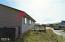 1937 NW Admiralty Cir, Waldport, OR 97394 - Rear & Canal