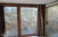 381 SE 130th Dr., South Beach, OR 97366 - Sun Room with view of deck and trees