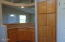 744 SE Winchell Dr, Depoe Bay, OR 97341 - Kitchen island and cabinets