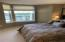 5856 SW Cupola Dr, South Beach, OR 97366 - view of guest bedroom from bath