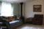 868 SW Siletz River Dr, Siletz, OR 97380 - Living room with woodstove