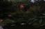 11668 SE Ash St, South Beach, OR 97366 - Garden at dusk