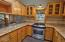 7031 SW Surfland St, South Beach, OR 97366 - Kitchen
