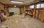 7031 SW Surfland St, South Beach, OR 97366 - Garage