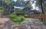 7031 SW Surfland St, South Beach, OR 97366 - Front