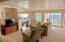 115 N Miller St, 202, WEEK J, Rockaway Beach, OR 97136 - Spacious living room with fireplace