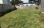 503 SE Keel, Lincoln City, OR 97367 - Fenced yard with fruit trees