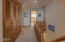 7858 SW Surfland St, South Beach, OR 97366 - upper hall and stairway down