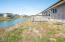 1937 NW Admiralty Cir, Waldport, OR 97394 - Deck overlooks canal
