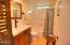 4929 NW Sandy Dr, Seal Rock, OR 97376 - Master Bathroom Tiled Shower