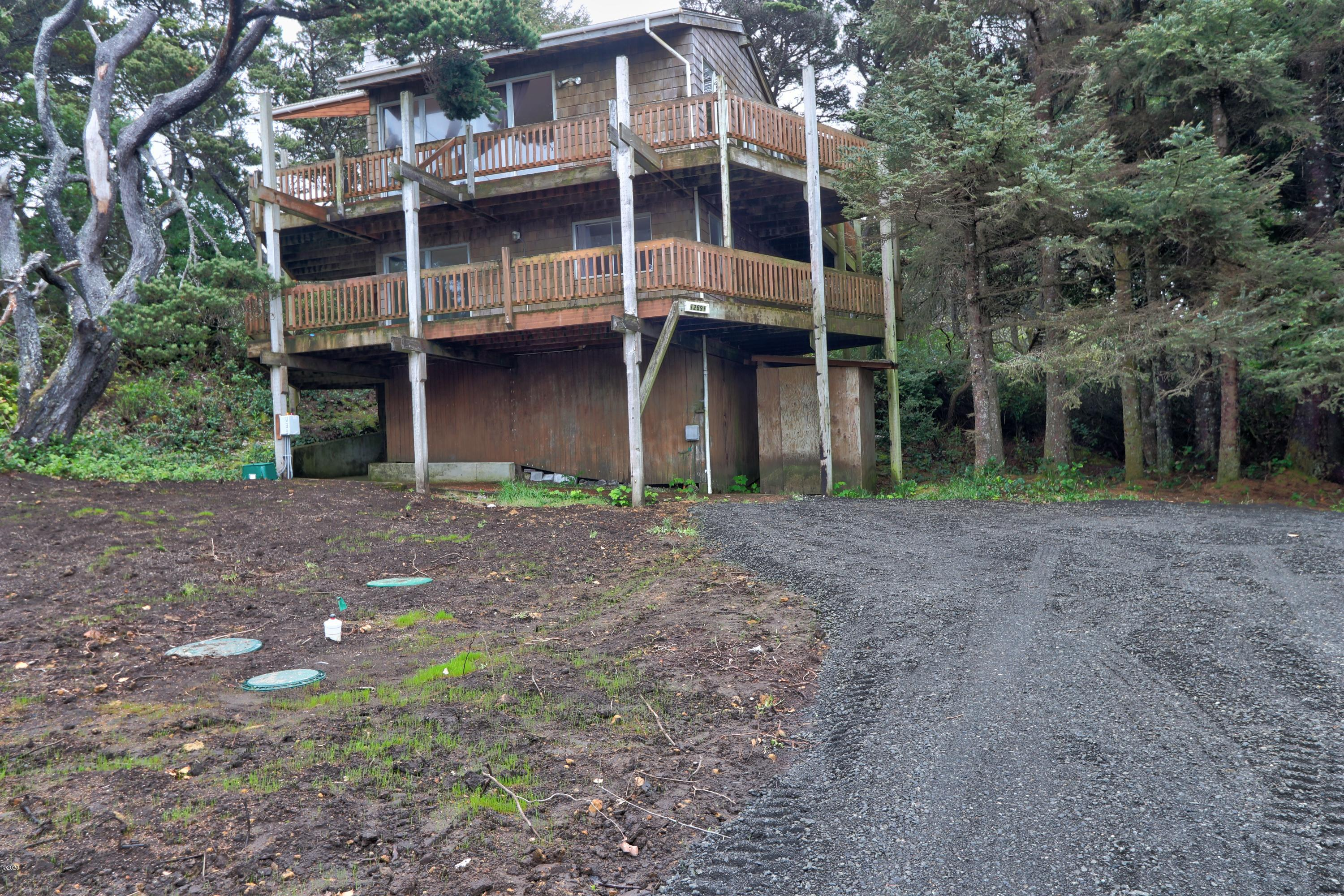 12791 NW Raspberry Ln, Seal Rock, OR 97376 - Front of home