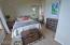 9040 NW Grandview St, Seal Rock, OR 97376 - One of two Upper Bedrooma