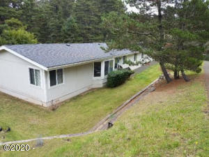 1097 NW Fox Creek Dr., Seal Rock, OR 97376 - house exterior