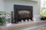 1015 SW Pine Ave, Depoe Bay, OR 97341 - Gas fireplace on raised hearth