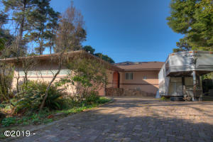 7332 SW Surfland St, South Beach, OR 97366 - front view with paver driveway