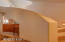 7332 SW Surfland St, South Beach, OR 97366 - curved stairway to bonus room