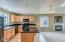 5733 NE Voyage Ave, Lincoln City, OR 97367 - Kitchen with granite counters