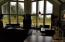 810 SW Wakeetum St, Waldport, OR 97394 - wall of windows in LR