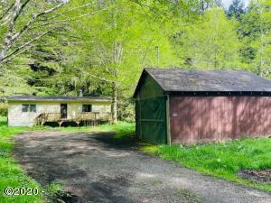 3702 S Schooner Creek Rd, Lincoln City, OR 97367 - Creek Front with 2 car Garage