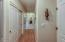 5460 El Mundo Ave, Lincoln City, OR 97367 - A wall of storage in lower level hallway