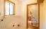 493 Elk City Rd, Toledo, OR 97391 - Laundry room and bathroom