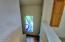 1540 SE Running Springs Ct, Newport, OR 97365 - Stairway with stained glass