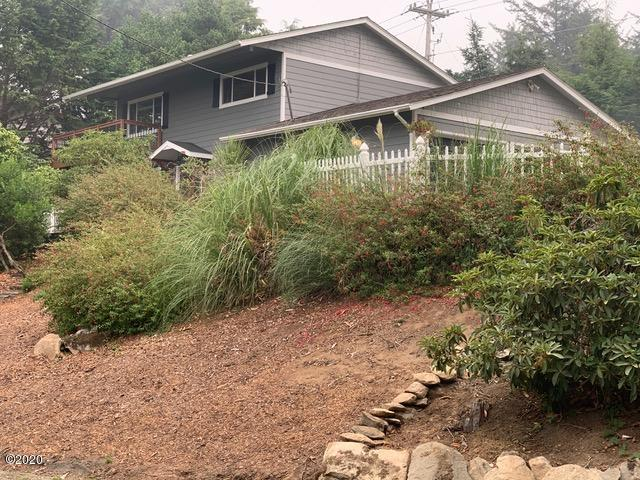 52 SW 95th St, South Beach, OR 97366-9714 - Font Elevation